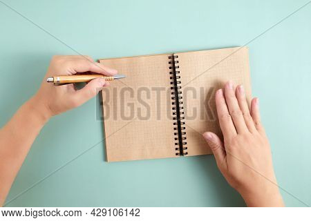 Happy Left Handers Day. Left Hand Hold Pen And Writing Text.