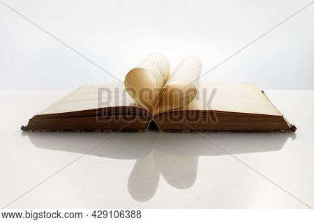 National Book Lovers Day. August 9. The Book Opens, And The Book Page Rolls Into The Heart