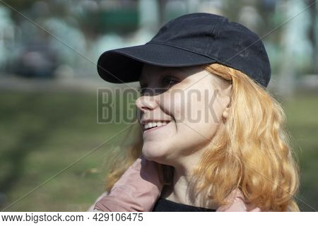 Girl In A Cap And Jacket. Portrait Of A Teenager In Autumn.
