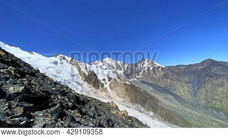 Hike Across The Caucasus. Snow-capped Mountains And Inaccessible Rocks. Mountain Landscape Of North