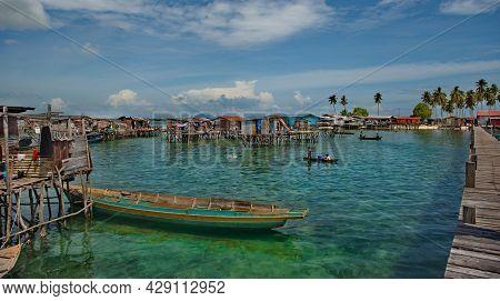Island Of Borneo. Malaysia. November 30, 2018. Sea Gypsy Village On A Sandy Coral Reef Island. The M