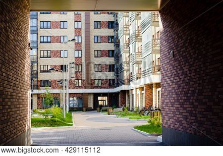 Courtyard Of An Apartment Building,  View From  Brick Arch.
