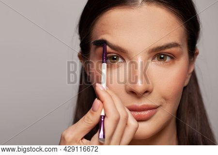 Professional Eyebrow Care And Make-up. Woman Face Close Up