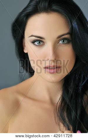 Attractive young brunette woman with blue eyes