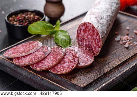 Spanish Dried Sausage Salami On A Dark Concrete Background
