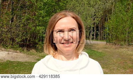 Funny Beautiful Mature Woman Face. Mid Adult Lady Smiling Outdoors. Portrait Of Female Age 55-60 Rel