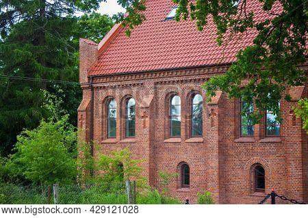 Old Red Bricks Church In Krasnolesye Village (former Gross Rominten) Of Kaliningrad Oblast, Russia.