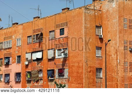 View Of The Red Walls Shabby Residential Buildings In Marrakech On A Sunny Day. Morocco.