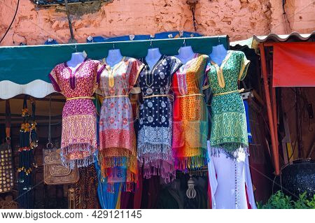 Sales Of The National Clothes At The Market In The Medina Of Marrakesh On A Sunny Day. Morocco.
