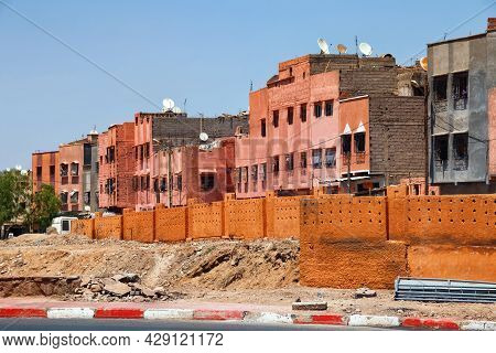 View Of The Red Walls Unfinished Residential Buildings In Marrakech On A Sunny Day. Morocco.