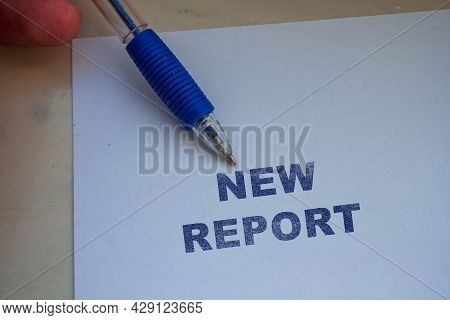 New Report Word Written On White Paper Sheet. Business
