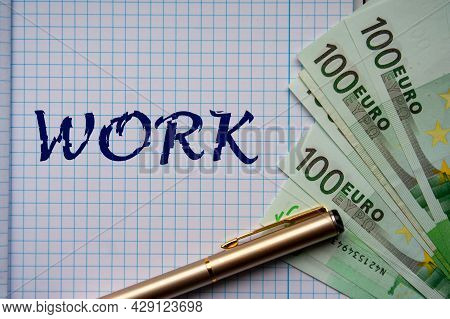 The Work Word On Notebook Page And Euro Banknotes. Financial Or Business Concept.