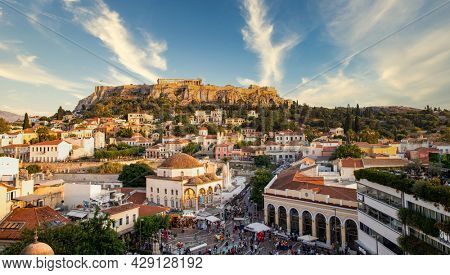 ATHENS, GREECE - 22 JUNE 2021: aerial panoramic view of Monastiraki square and the Acropolis at sunset in Athens  Greece