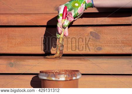 Painting Of Terrace Boards With Impregnation, Varnish Or Wax To Protect Wood, Repair And Renovation