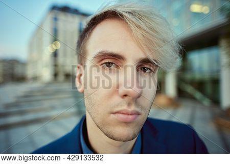 Portrait Of White Collar Worker Near Office Building.