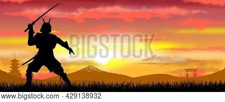 Japanese Samurai Warrior With A Sword At Sunset. A Man Stands With A Sword In His Hands Against The