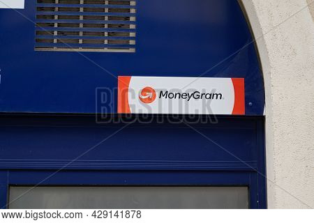 Montpellier , Occitanie France  - 06 25 2021 : Moneygram Sign Text And Logo Brand Front Of Agency Sh