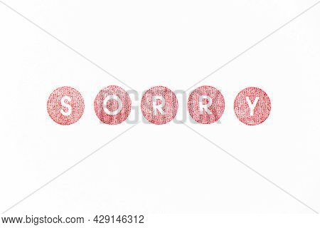 Red Color Rubber Stamp In Word Sorry On White Paper Background