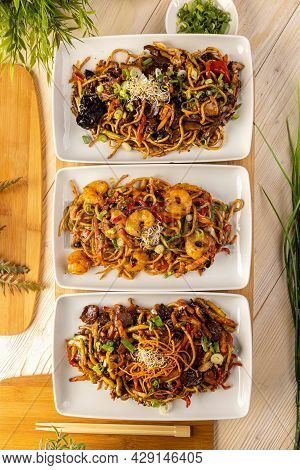 Top View Of Three Asian Food Dishes. Three Plate With Stir Fry Noodles.