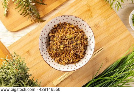 Top View Fried Rice In The Bowl On The Wooden Table