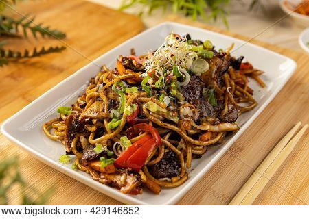 Close Up Of Noodles Stir Fry With Ear Wood Mushrooms And Vegetables