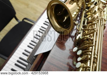Beautiful Saxophone On Piano, Closeup. Space For Text