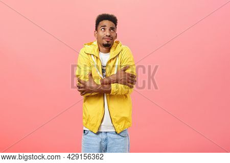 Cute African American Guy Freezing Cold While Waiting For Girlfriend Under Window Trembling Hugging