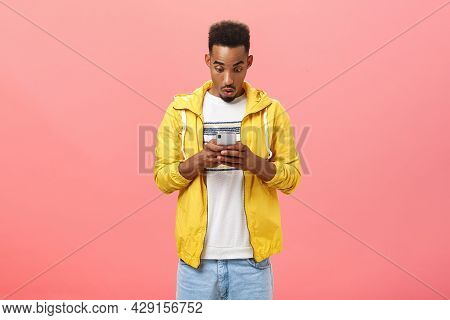 Boyfriend Received Intriguing Message Holding Smartphone Looking Impressed At Device Screen Saying W