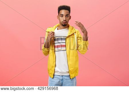 Guy Dressed Up Unappropriatly For Hot Weather Sweating Breathing Out And Making Wind With Shook Palm