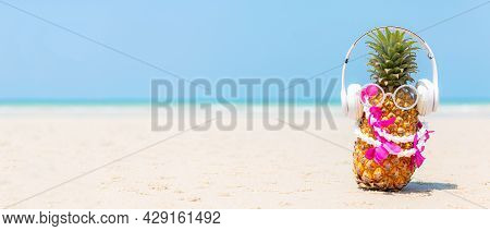 Summer In The Party.  Hipster Pineapple Fashion In Sunglass And Listen Music On The Sand Beach Beaut