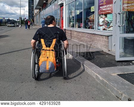 St. Petersburg, Russia-august 2021. A Disabled Person Sitting In A Wheelchair Is Waiting For Help To
