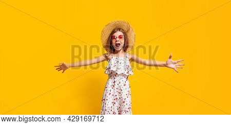 Energetic Teenager In Stylish Summer Dress And Straw Hat Screaming And Looking At Camera While Jumpi