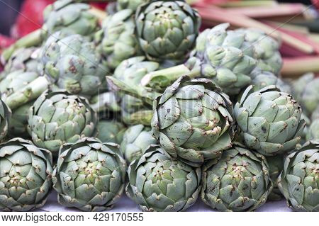 Close-up On A Stack Of Artichokes On A Market Stall.