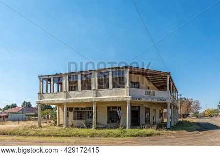Rouxville, South Africa - April 23, 2021: A Street Scene, With The Ruin Of A Old Hardware Store, In