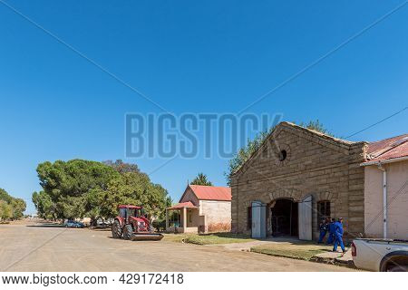 Rouxville, South Africa - April 23, 2021: A Street Scene, With Old Buildings, People And A Frontload