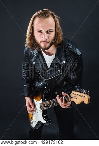 Bearded Rock Musician Playing Electric Guitar In Leather Jacket, Electric Bass