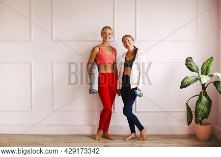 Two Joyful Lovely Happy Women Of Different Ages Having Fun Together On Yoga Training, Broadly Smilin