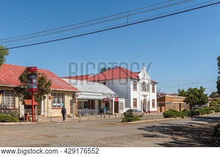 Rouxville, South Africa - April 23, 2021: A Street Scene, With Buildings, People And A Vehicle, In R