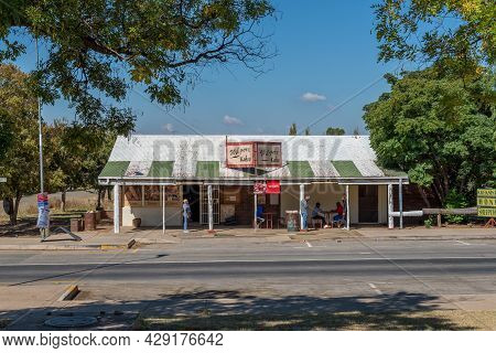 Smithfield, South Africa - April 23, 2021: A Street Scene, With The Wilgers Cafe And People, In Smit