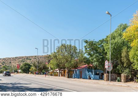 Smithfield, South Africa - April 23, 2021: A Street Scene, With Businesses, People And A Vehicle, In