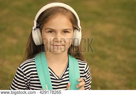 English Is Meant To Learn. Small Kid Wear Headphones. English School. Language Education. Listening