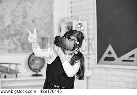 Headshot Kills. Virtual Classes. Vr Technology. Schoolgirl Using Virtual Reality Helmet. Virtual Rea
