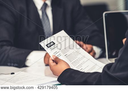 Human Resources Department Manager Reads Cv Resume Document Of An Employee Candidate At Interview Ro