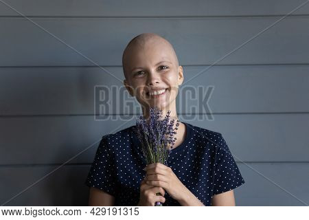 Happy Oncology Patient Holding Bunch Of Wild Flowers