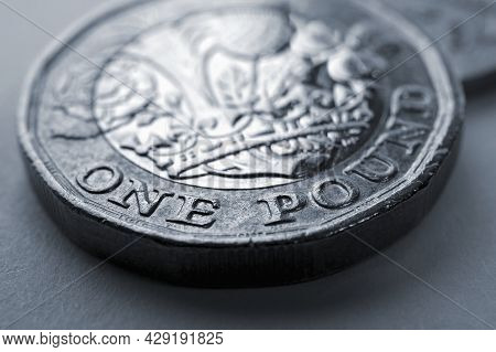 1 One British Pound Coin Close-up. Grey Tinted Background About Economy, Business, Finance Or Bankin