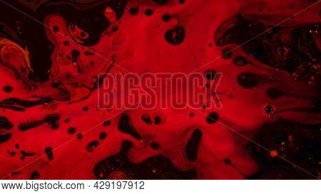 Dark Blood With Bubbles. Footage. Thick Blood With Bubbles Flows Slowly In Dark. Foam Flows Slowly I