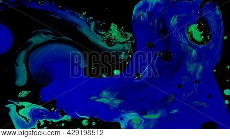 Fluid Art On Water. Footage. Beautiful Streaks Of Colors With Neon Shades. Colors Are Mixed Into Pat