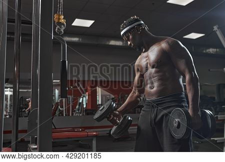 African American Athletic Man Exercising With Dumbbells In Gym. Training, Losing Weight And Healthy