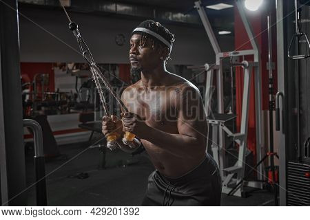 Muscular Athletic African American Man Training In Gym. Bodybuilding Sport, Strength Workout