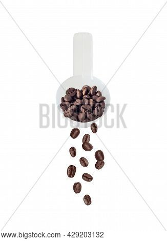 Roasted Coffee Beans Falling From Plastic Measuring Scoop